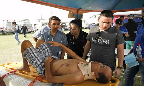 An injured man is attended to at the Maximino Puertas stadium as rescue efforts continue in Pedernales, after an earthquake struck off Ecuador's Pacific coast